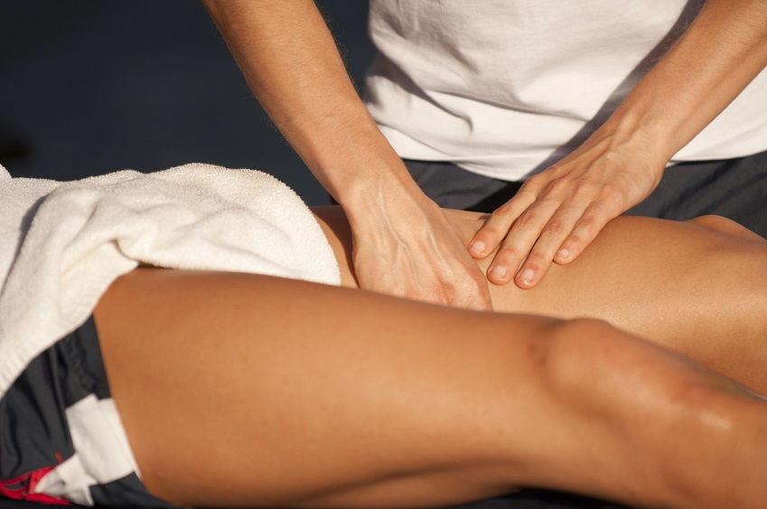 Close up of persons legs receiving a physiotherapy massage.