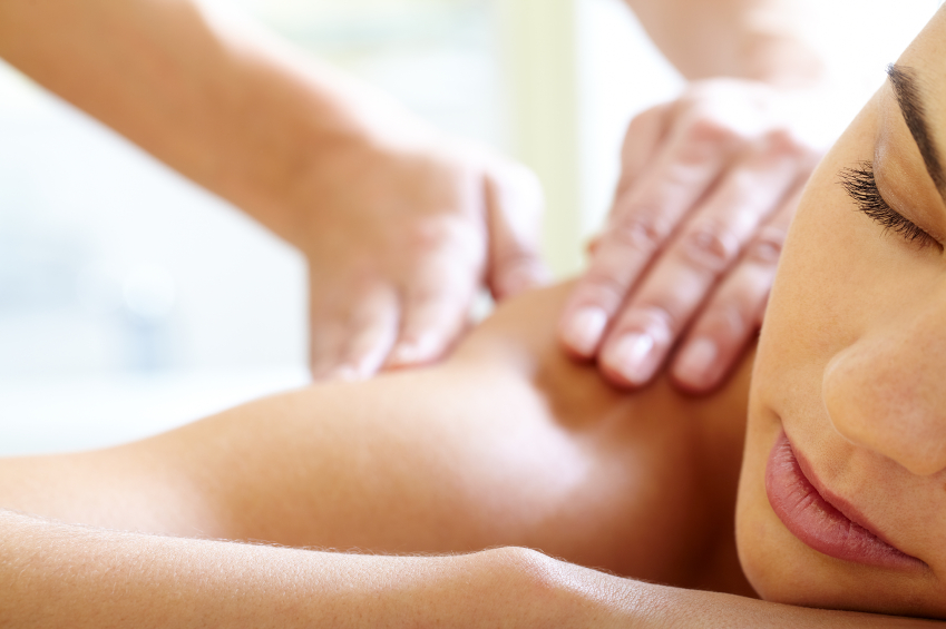Close up of womans face while lying down receiving a massage.