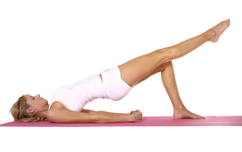 Lady doing Pilates on a mat