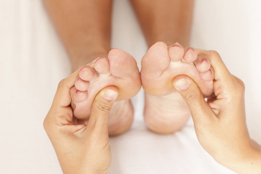 Pair of hands on feet.