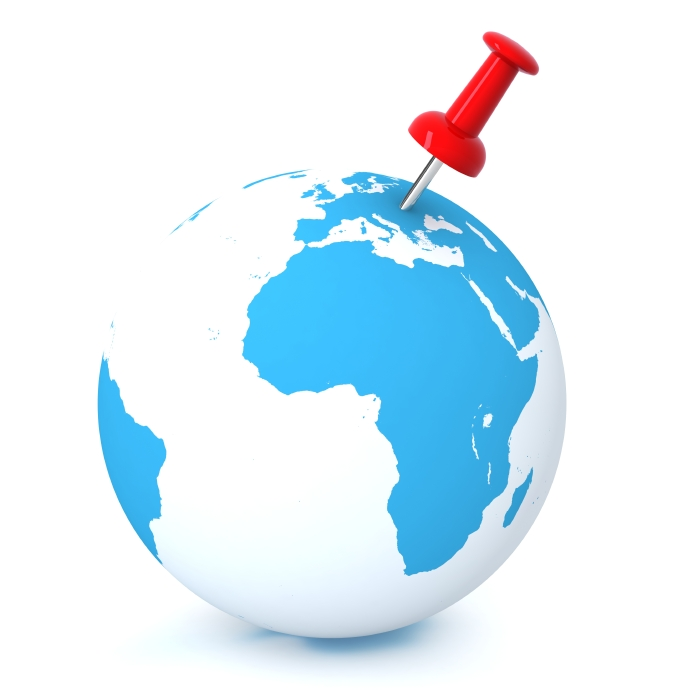 Blue and white earth globe with safety pin attached to globe.